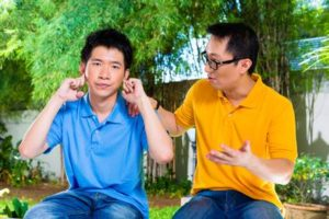 Both/And Parenting.Fotolia.GIFT.Asian dad son.lecture