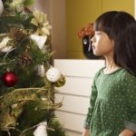 On this Day of Your Birth....little asian girl sits next to christmas tree