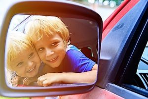 happy little boy and girl travel by car, family travel