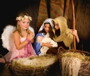 On this Day of Your Birth....Little 7 year old angel visiting a nativity scene reenacted with a doll