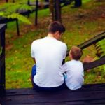Intentionality and Parenting in a Time of Social Unrest.Dad talks to son